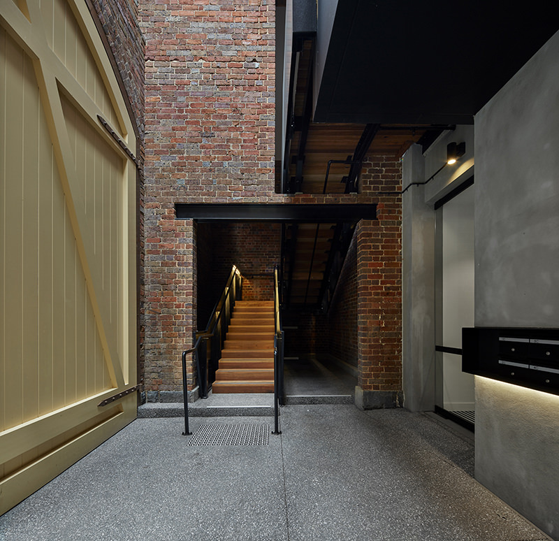 Interior view of the massive entry door at the Yorkshire Brewery Apartments in Collingwood
